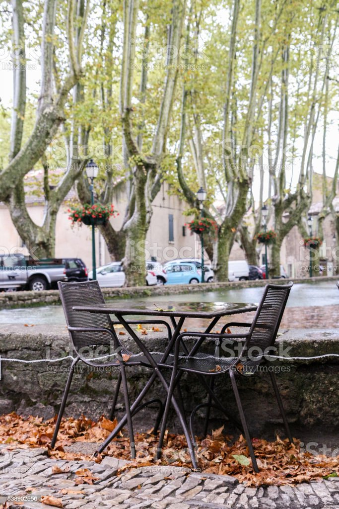 Tables and chairs of street cafes in the town square stock photo