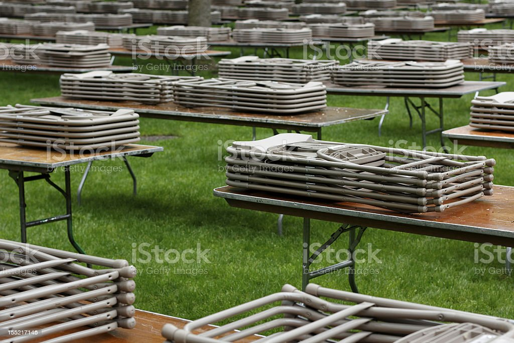 Tables and Chairs on a Lawn stock photo