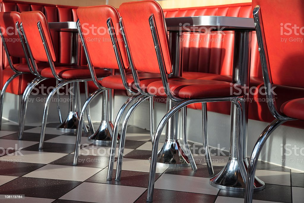 Tables and Red Leather Chairs in the Fast Food Restaurant stock photo