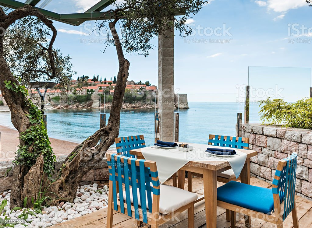 Tables at seaside restaurant stock photo