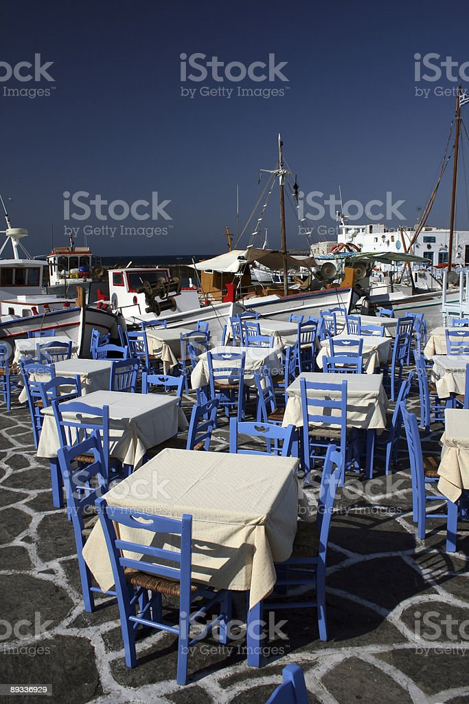 Tables by the old harbor - Paros, Greece royalty-free stock photo