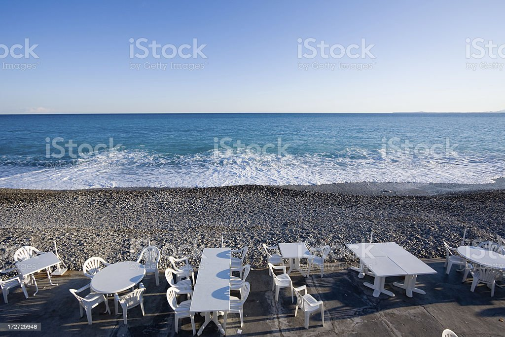 Tables on the beach at sunset royalty-free stock photo