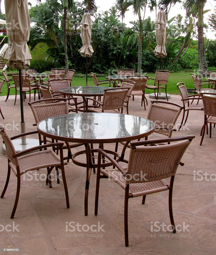 Tables, umbrellas and chairs on an outside patio stock photo