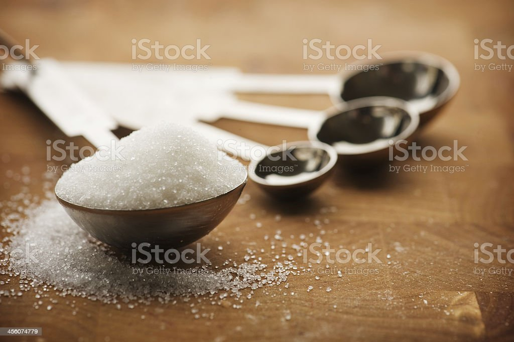 Tablespoon filled with granulated sugar stock photo