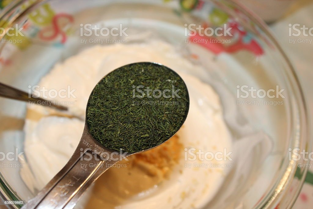 Tablespoon of Dill stock photo