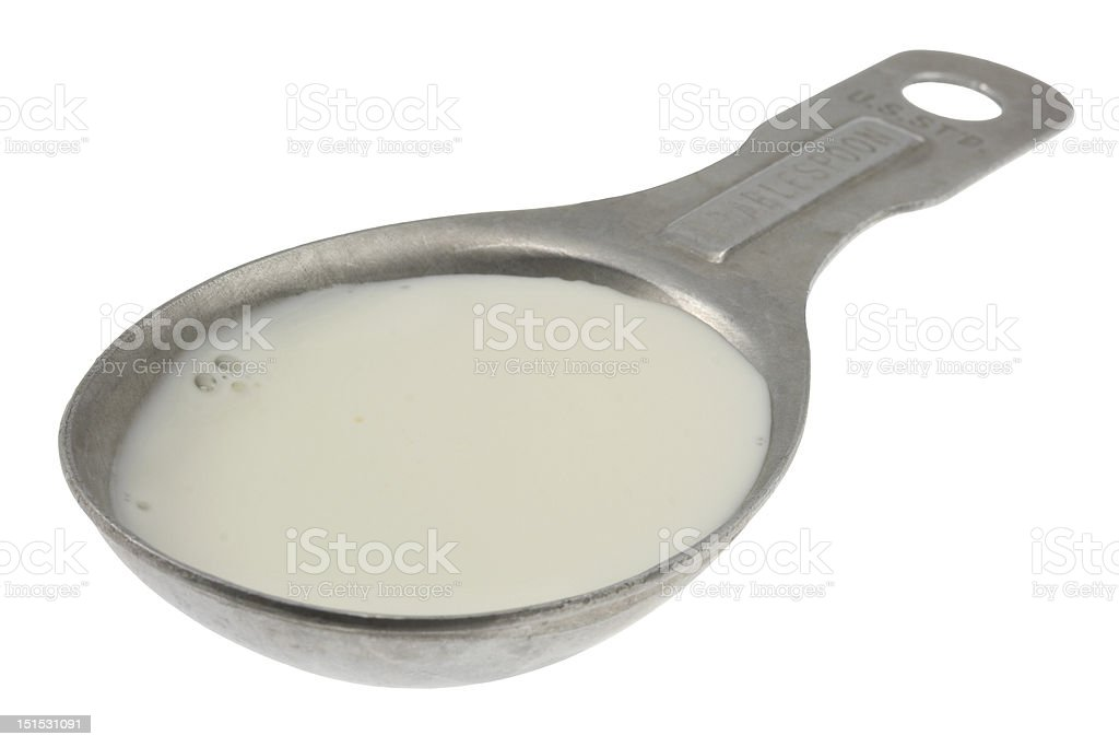 tablespoon of milk or creamer stock photo