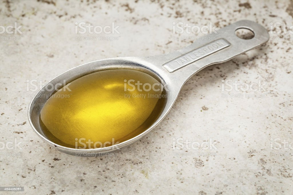 tablespoon of olive oil stock photo