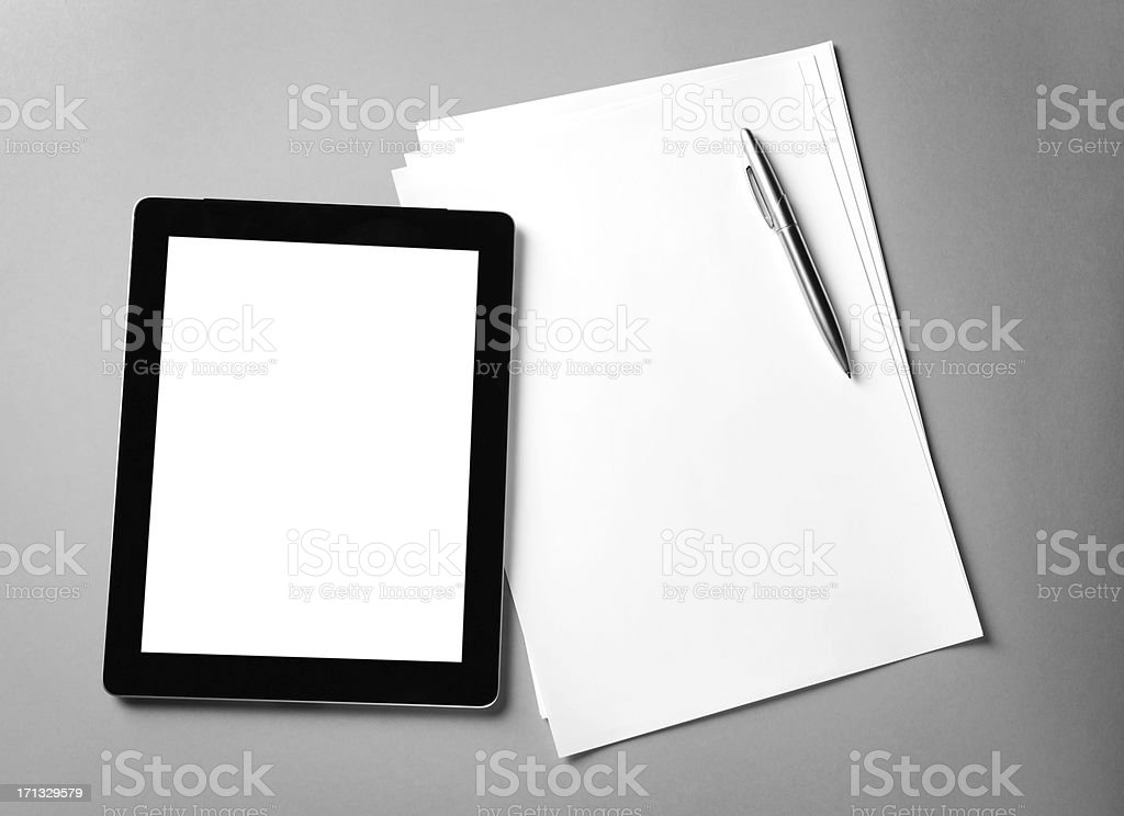 Tablet and blank papers stock photo