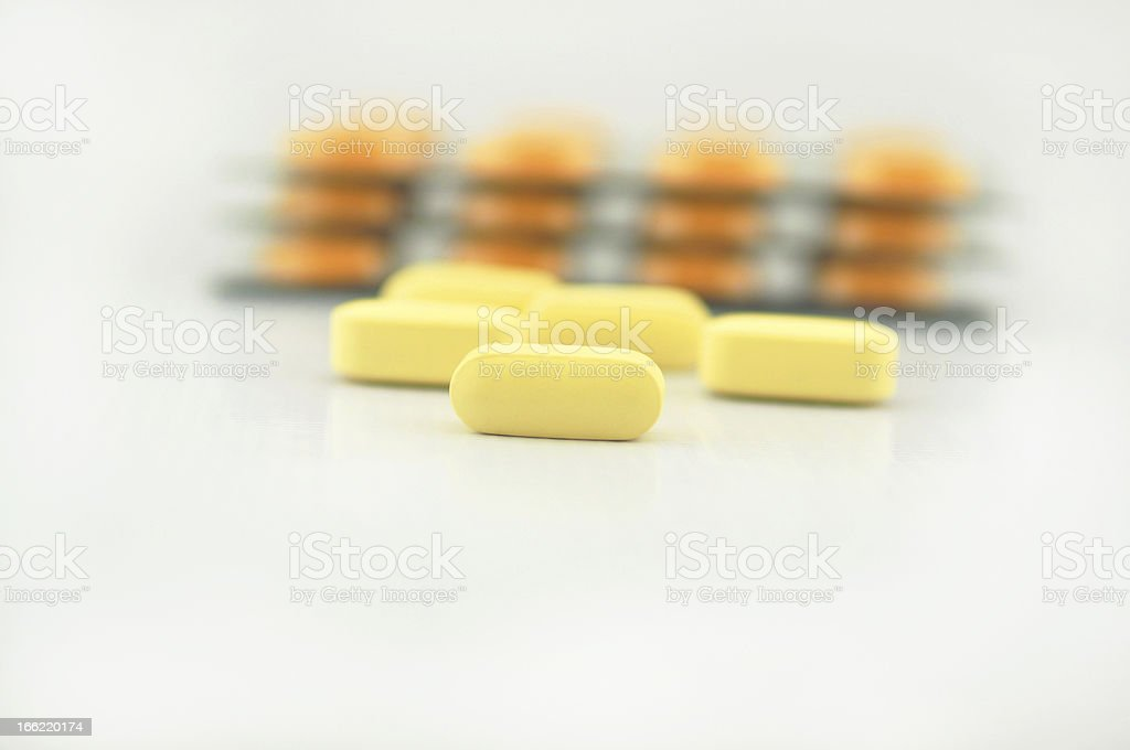 Tablet and blister pack background royalty-free stock photo