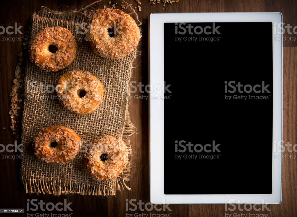 Tablet and cookies stock photo