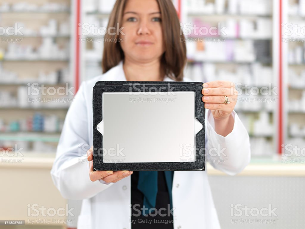 Tablet and Pharmacist royalty-free stock photo