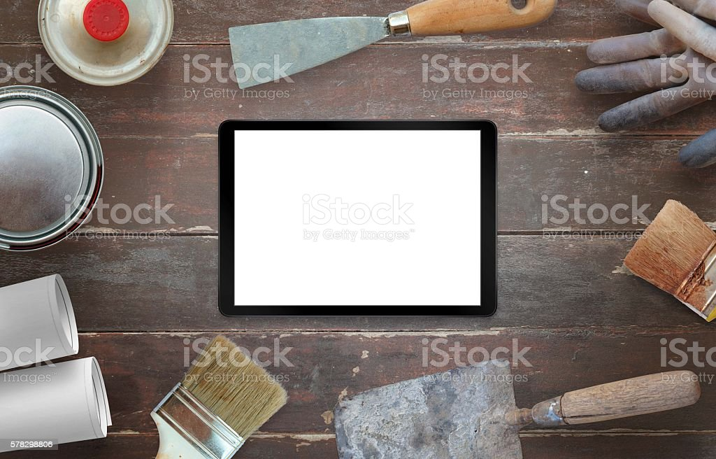 Tablet and tools for house renovation. stock photo