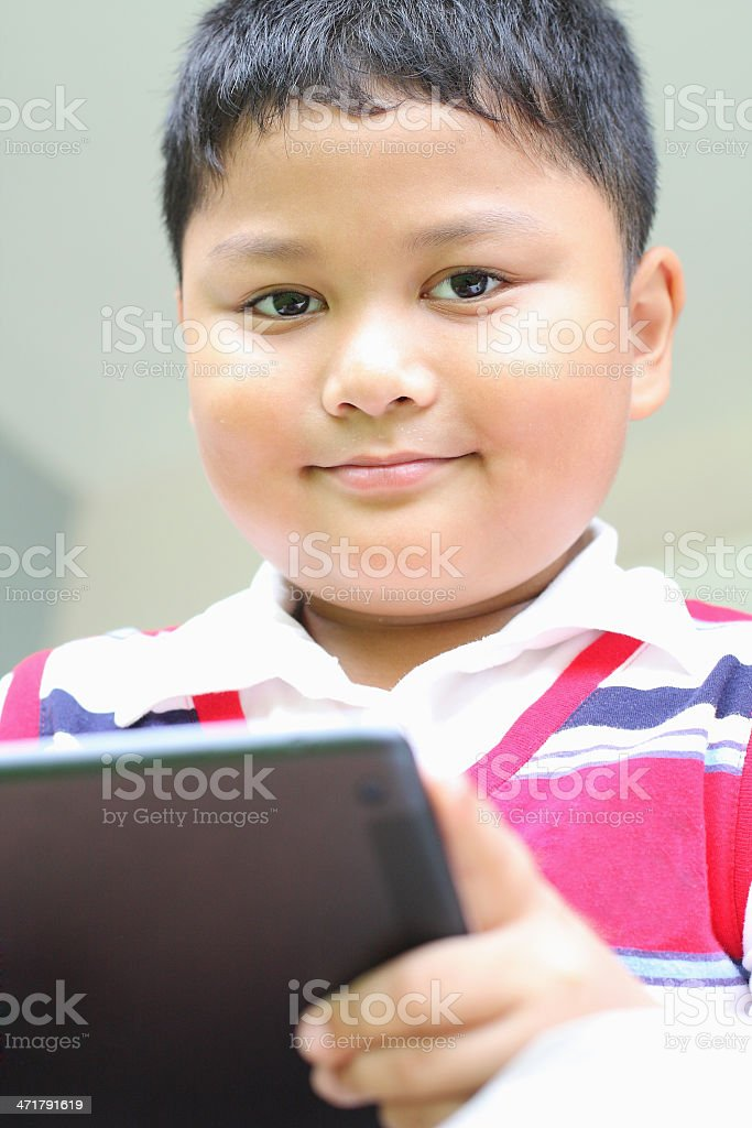 Tablet boy playing fun. royalty-free stock photo