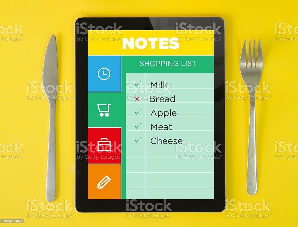 tablet breakfast shopping list on note app stock photo