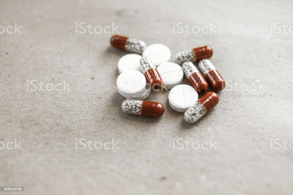 Tablet capsule on paper stock photo