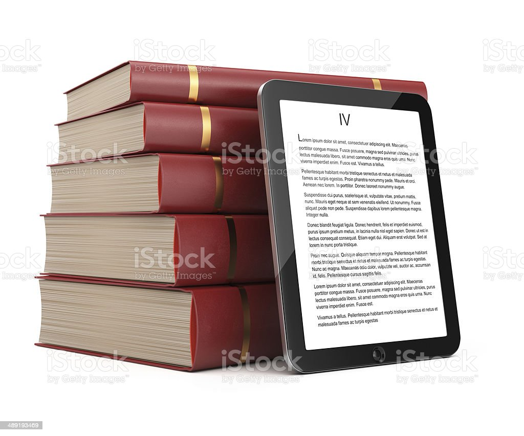 Tablet computer and stack of books royalty-free stock photo