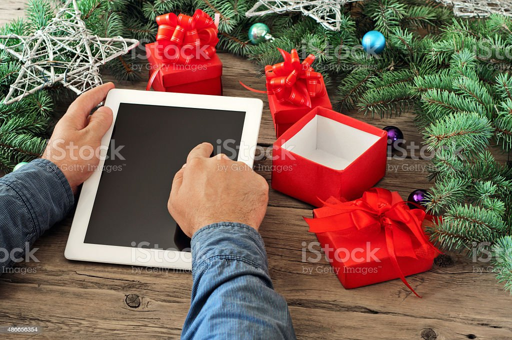 Tablet computer in men hands stock photo