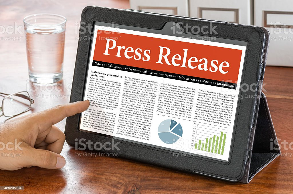 Tablet computer on a desk - Press Release stock photo