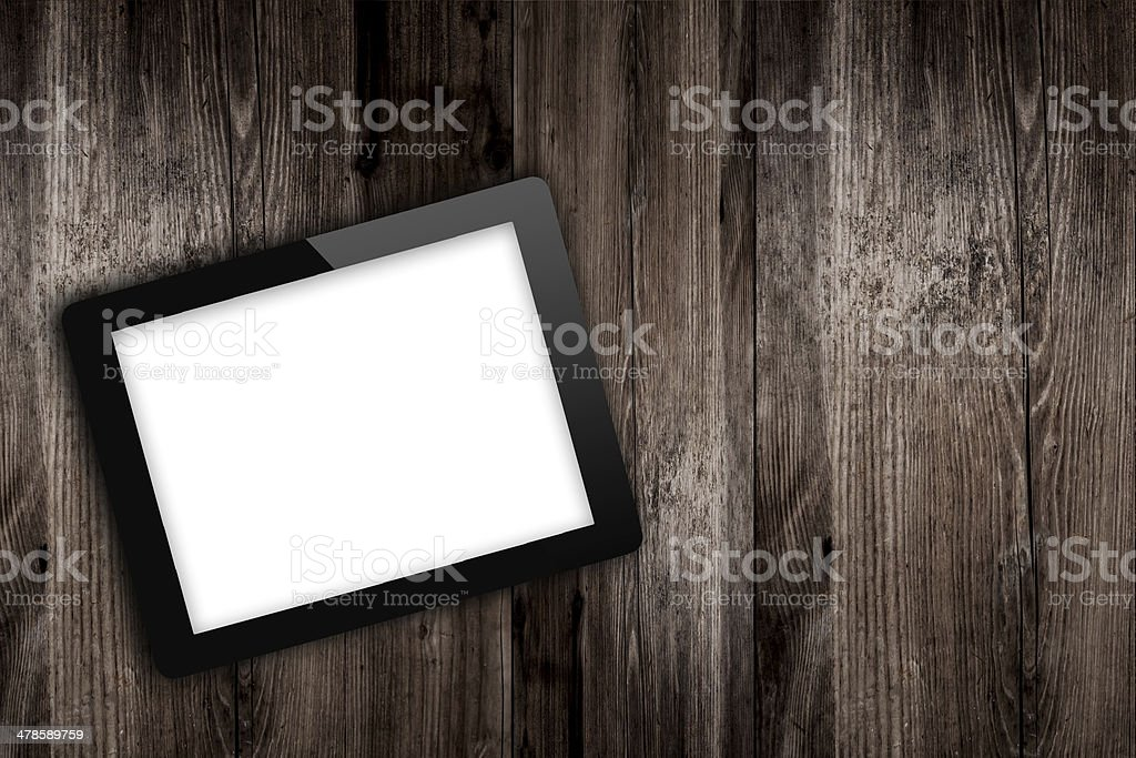 tablet computer on old wooden table stock photo