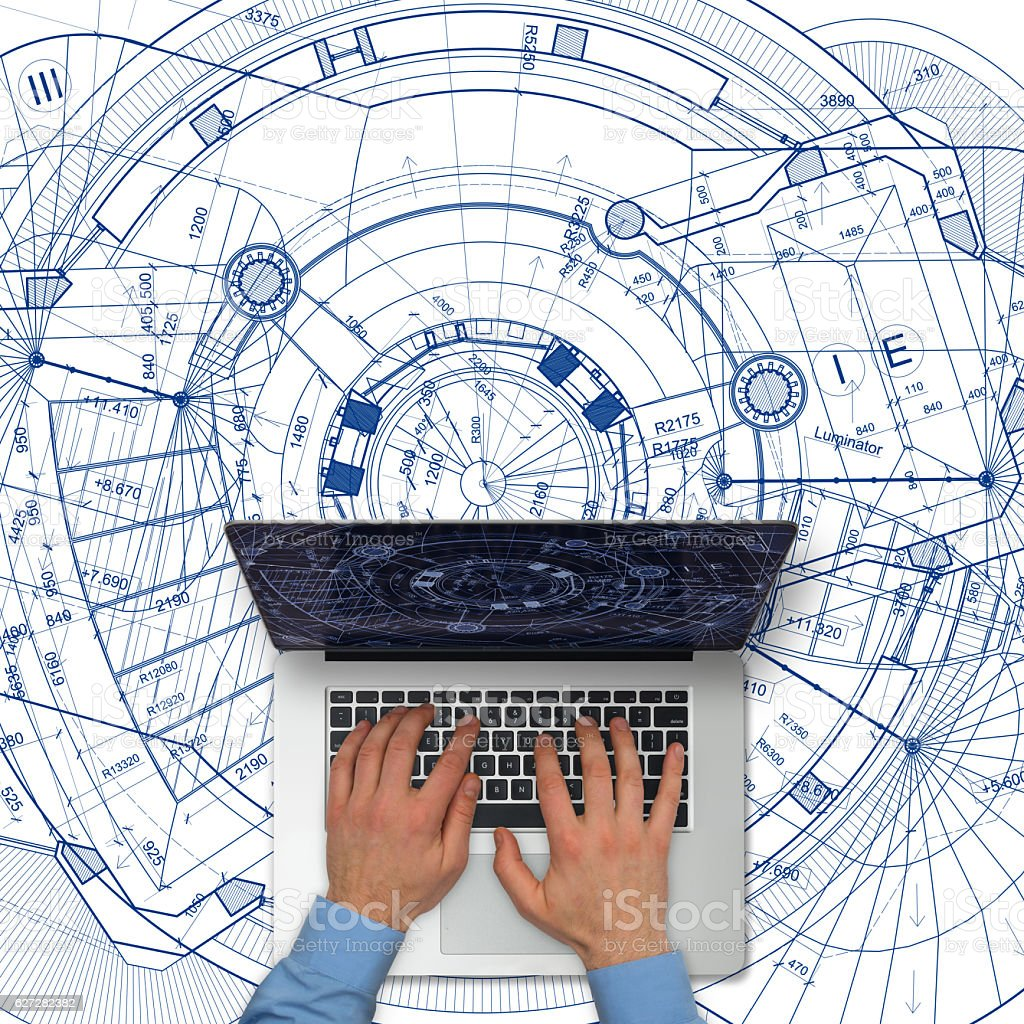 Tablet computer over architectural blueprints on white background stock photo