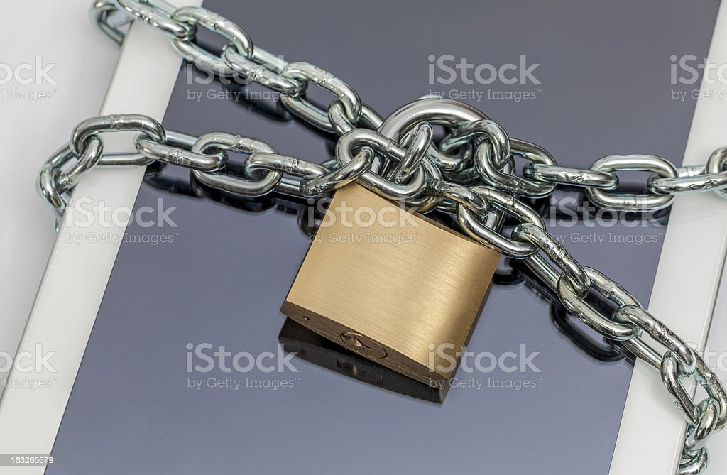 tablet computer with chain and padlock stock photo