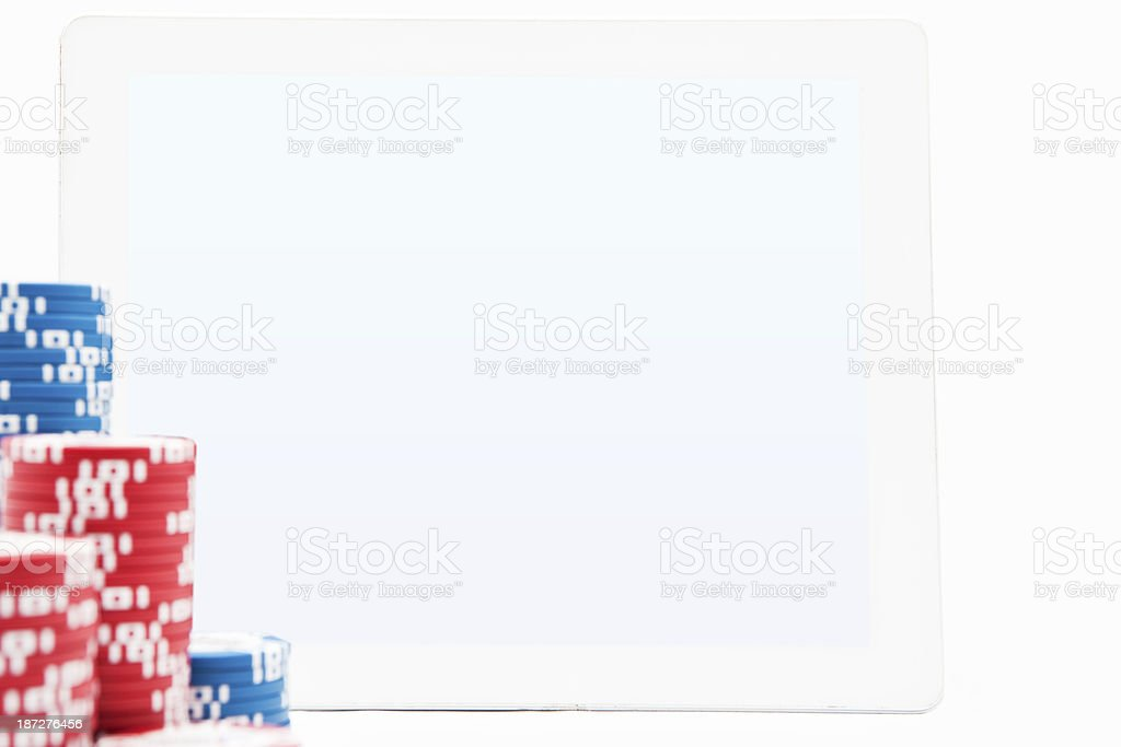 Tablet Computer with Poker Chips stock photo