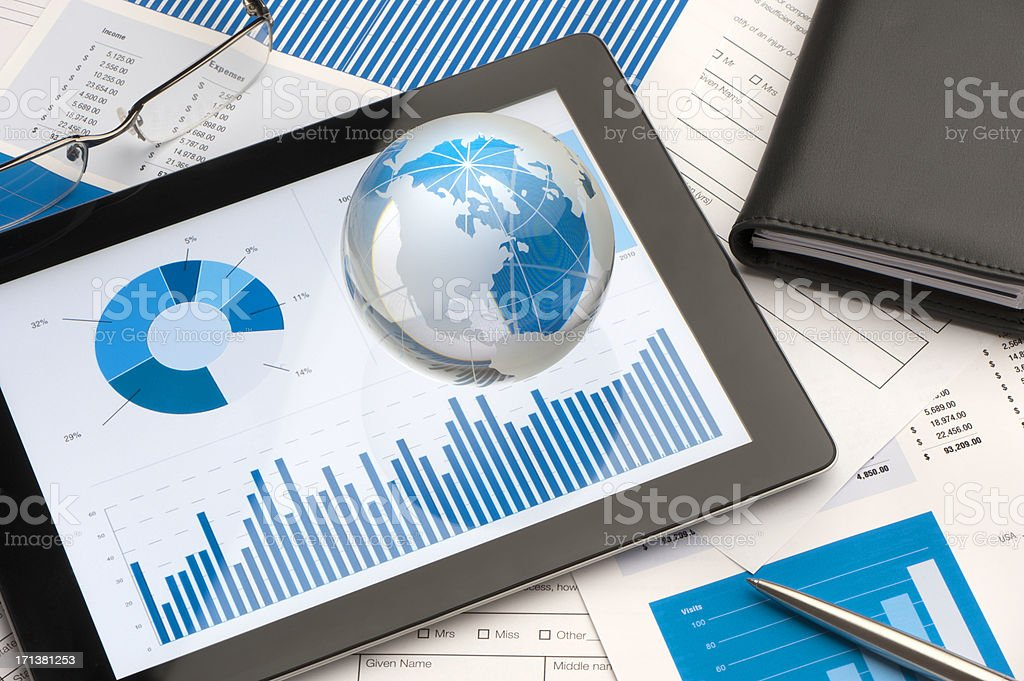 Tablet device with business presentation  and business models stock photo
