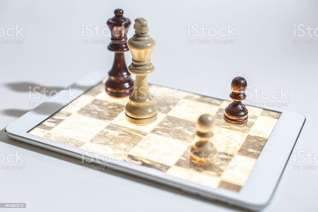 tablet gaming chess stock photo