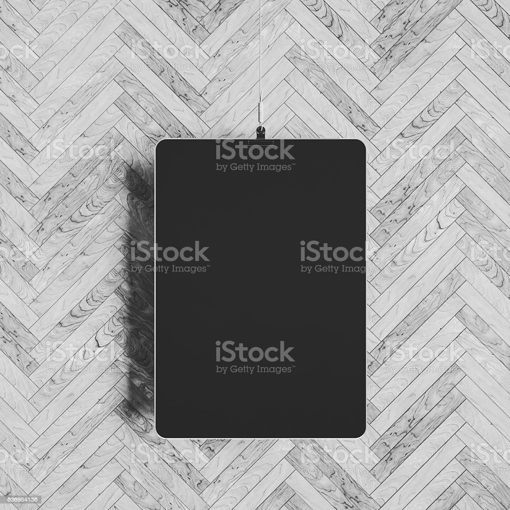 Tablet hanging over wall. 3D illustration stock photo