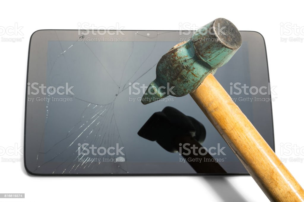 Tablet hit with hammer to break the fake isolated on white background. stock photo