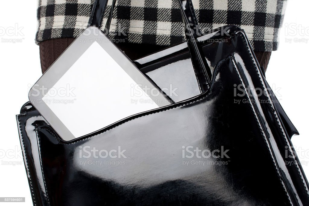tablet in black purse stock photo