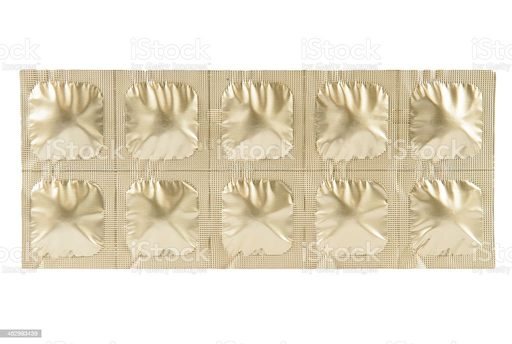 Tablet in gold aluminum strip pack royalty-free stock photo