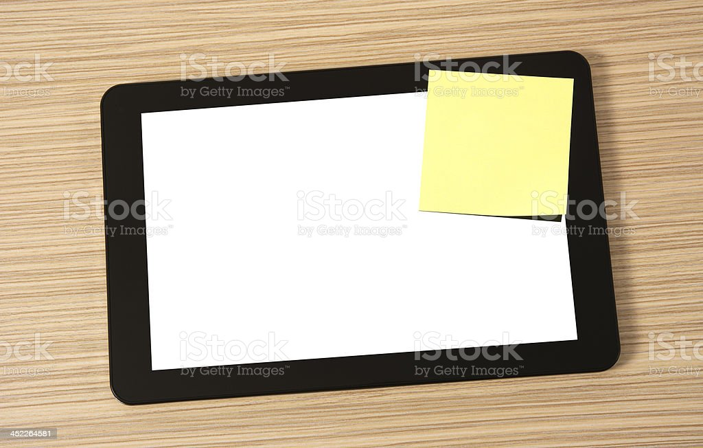 Tablet on a desk stock photo