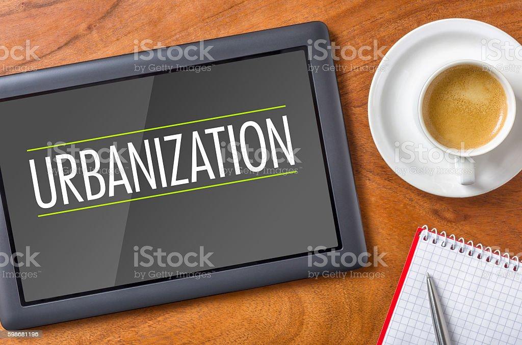Tablet on a desk - Urbanization stock photo
