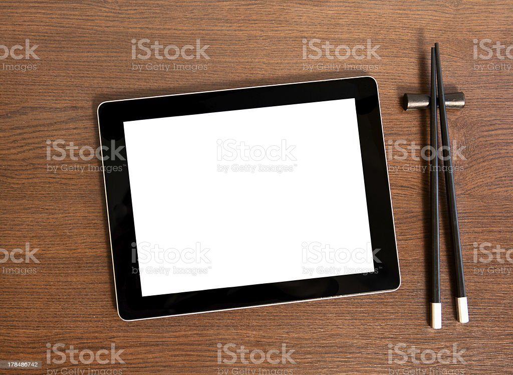 Tablet on a table near sushi royalty-free stock photo