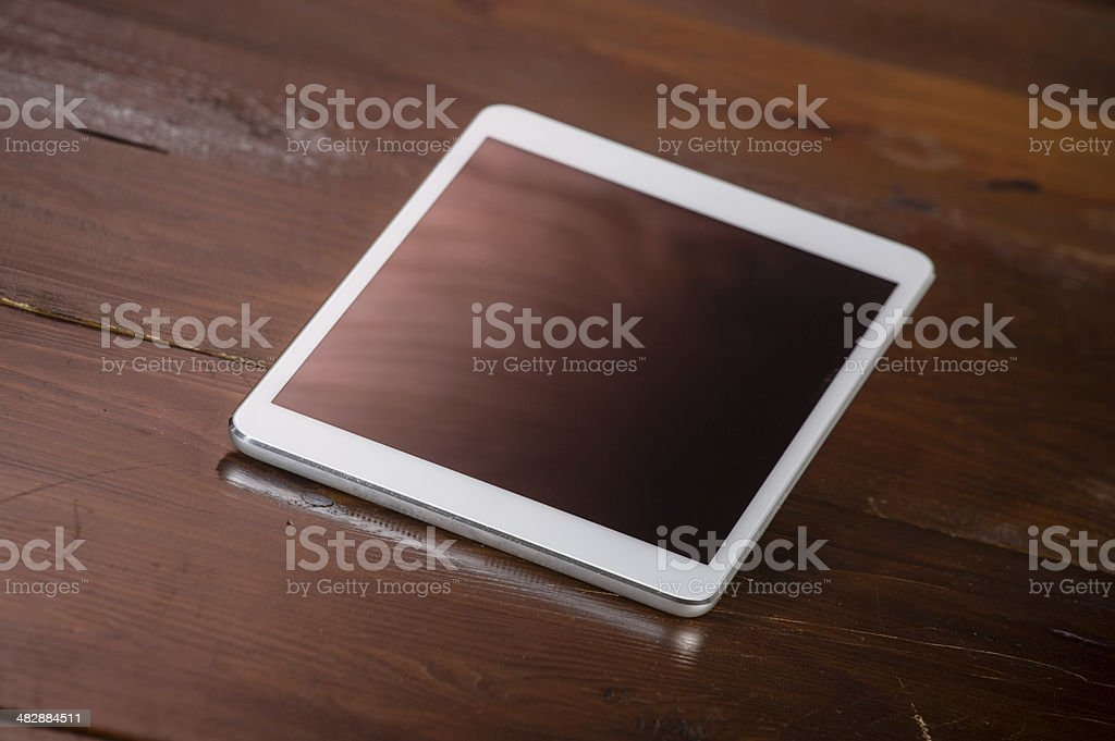 Tablet on colored background royalty-free stock photo