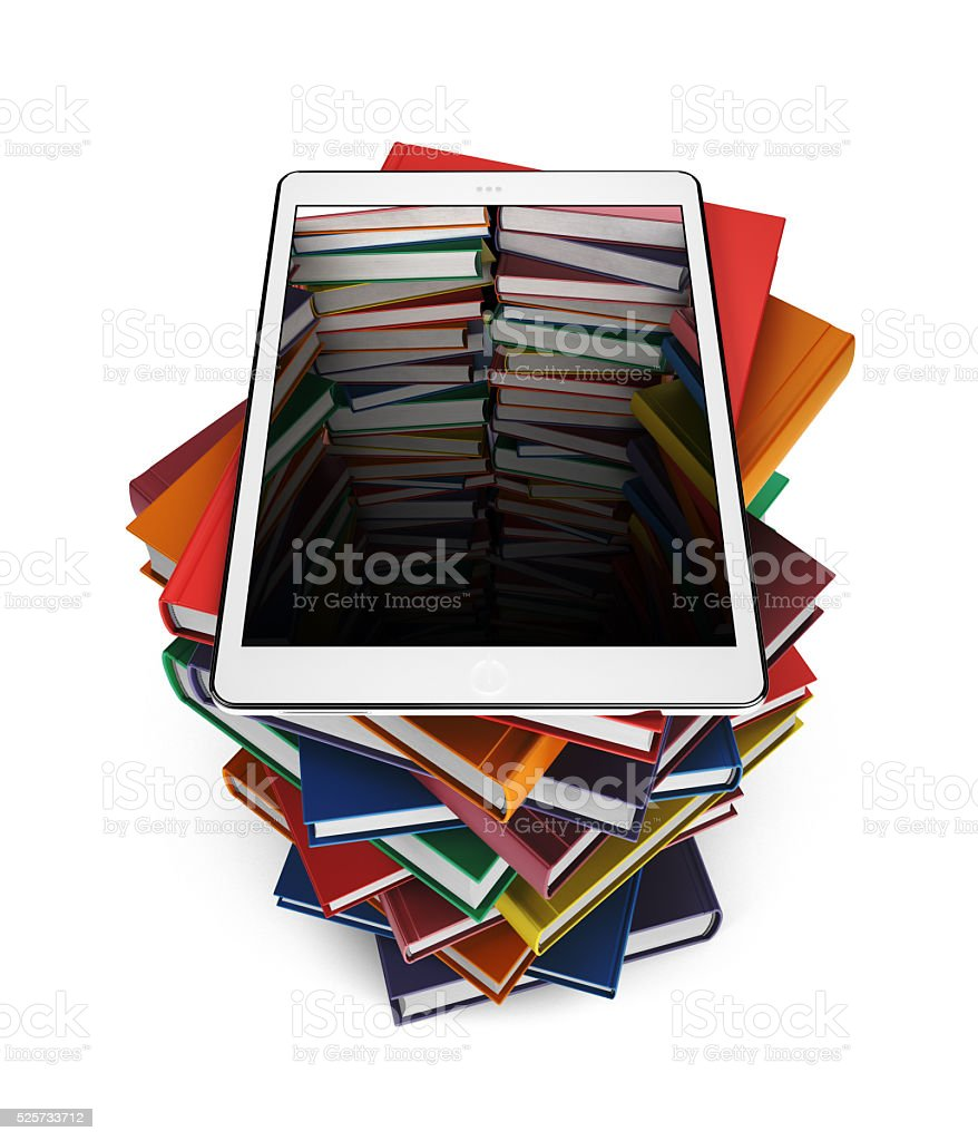 Tablet on stack of books stock photo