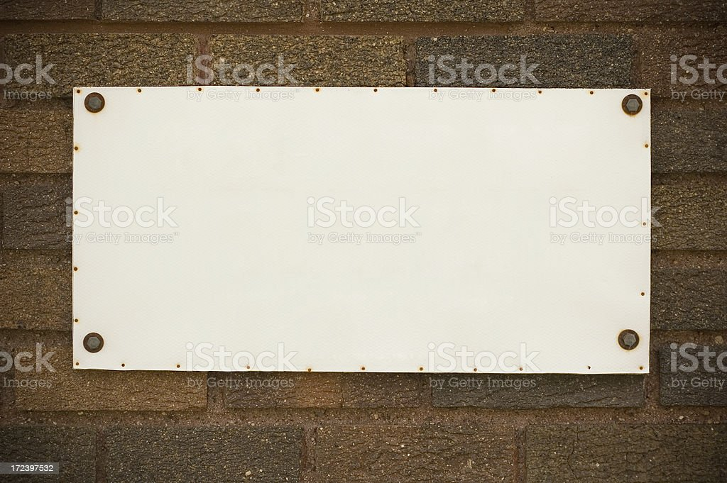 Tablet on the brick wall stock photo