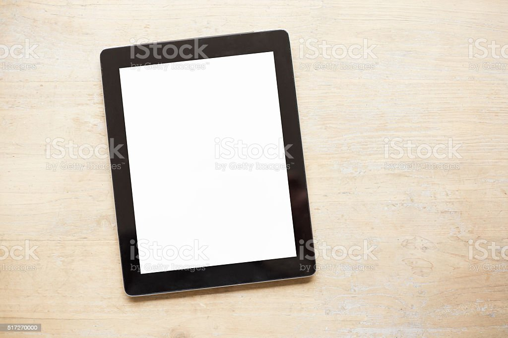 Tablet on wooden table stock photo