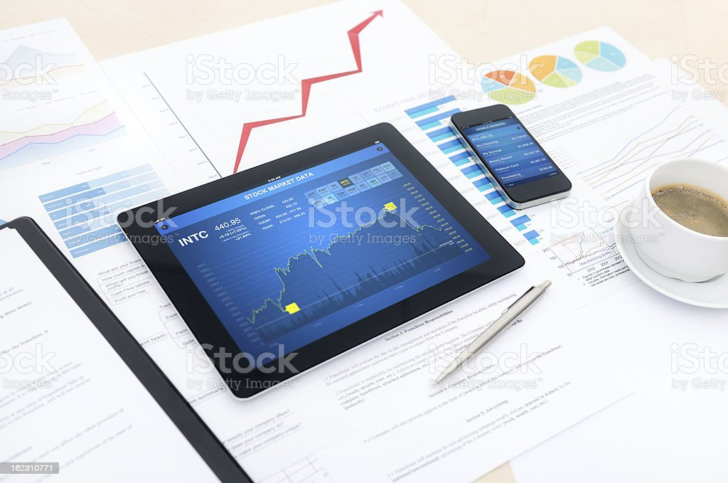 Tablet PC and smartphone on table with papers royalty-free stock photo