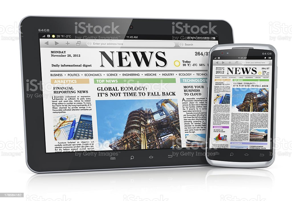 Tablet PC and smartphone with business news stock photo