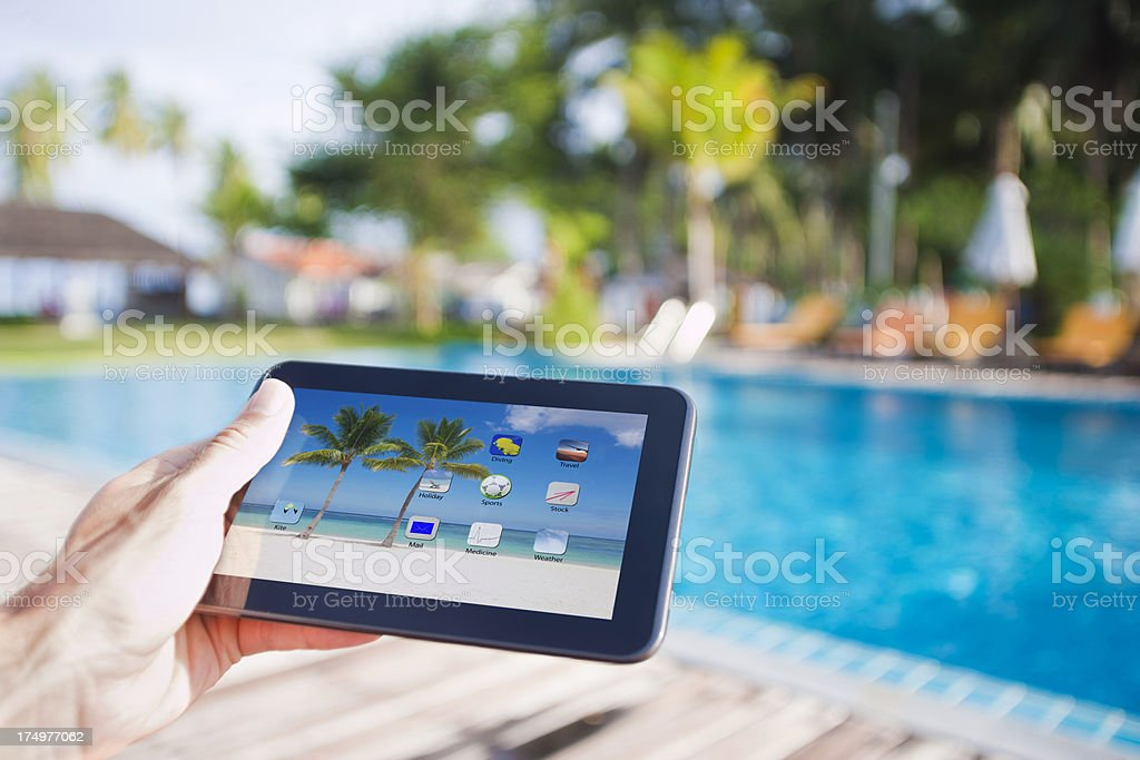 Tablet PC at the pool stock photo