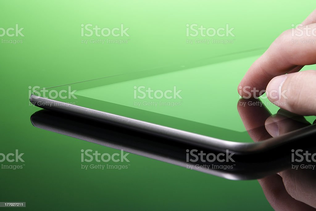 Tablet PC is green (eco) royalty-free stock photo