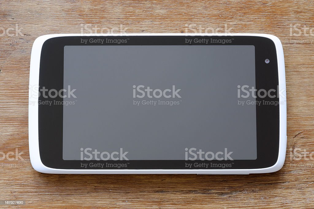 tablet pc on wood royalty-free stock photo