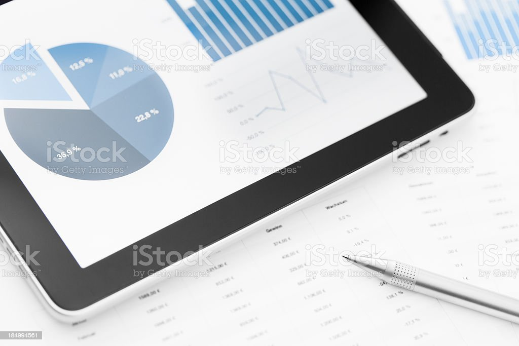 Tablet PC, paper and pen on table royalty-free stock photo