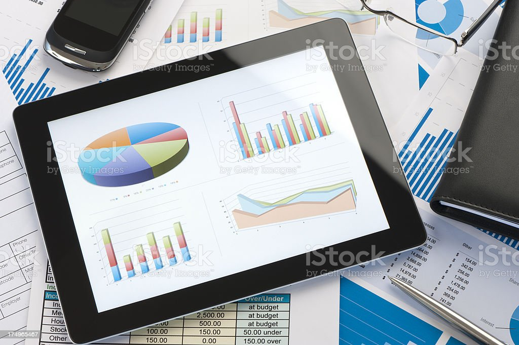 Tablet PC showing stock charts stock photo