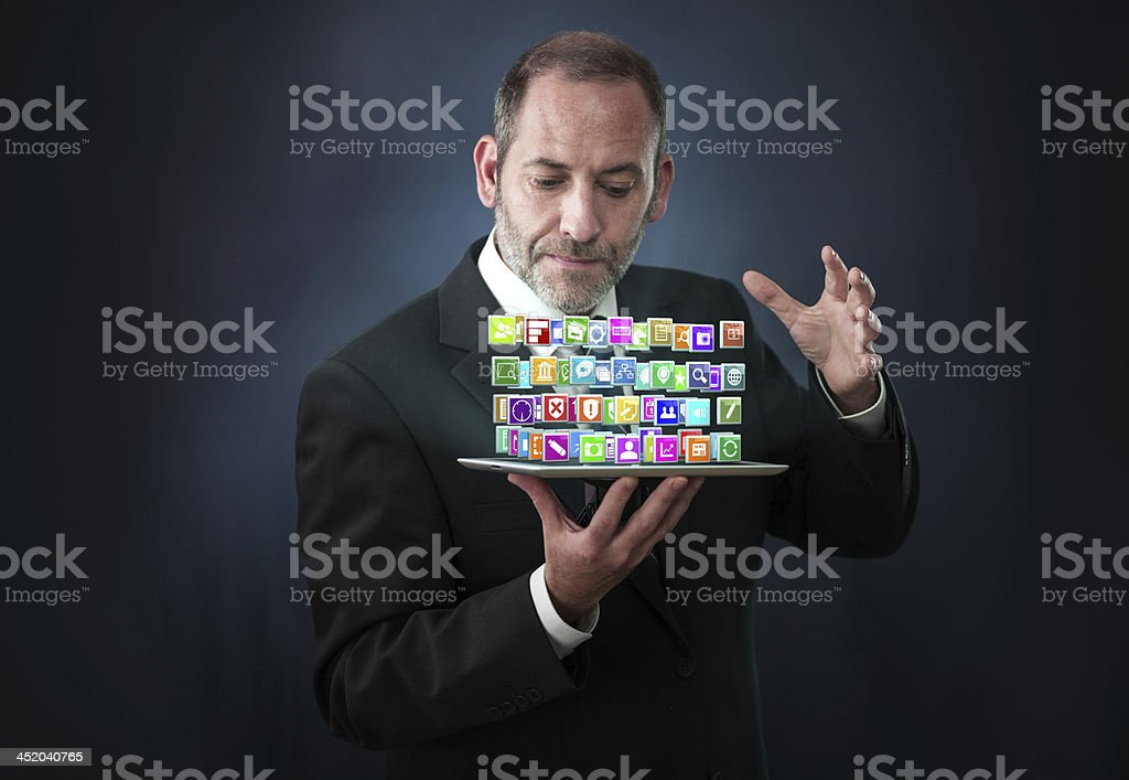 Tablet PC with cloud of application icons royalty-free stock photo
