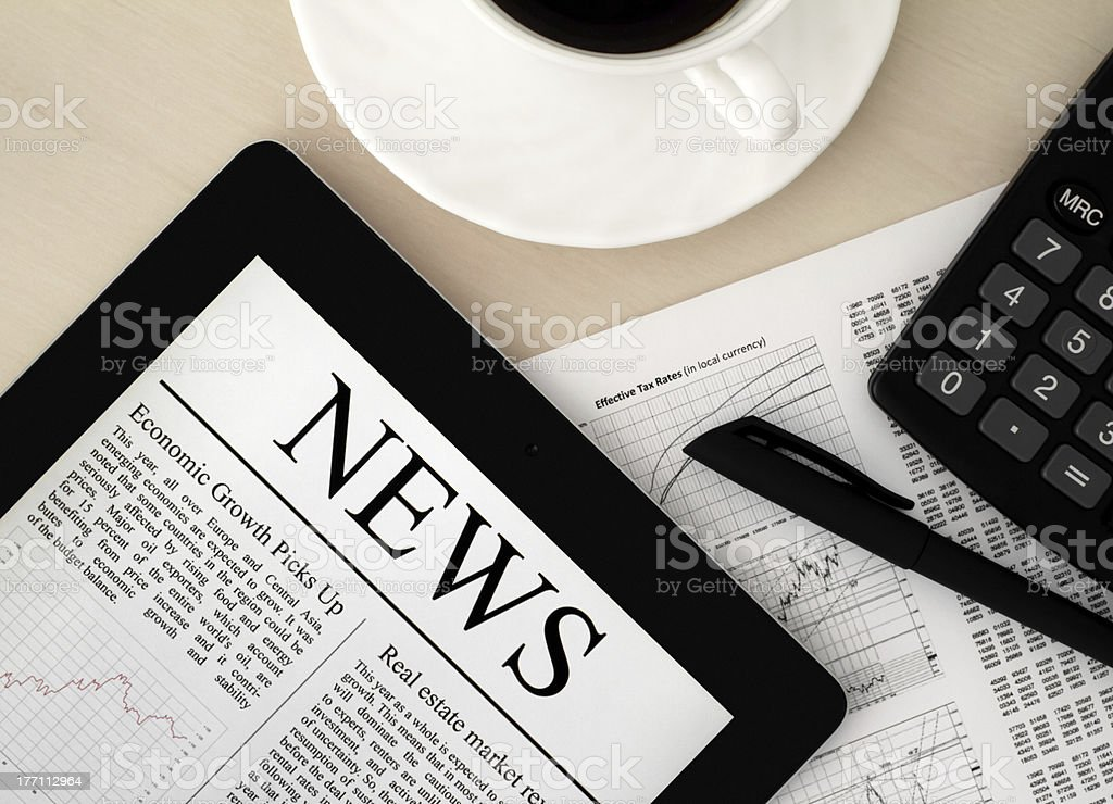 Tablet PC With News On Desk royalty-free stock photo
