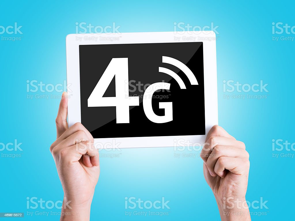 Tablet pc with text 4G with blue background stock photo