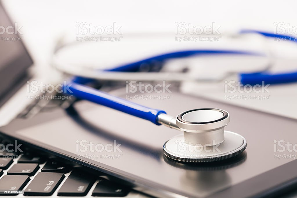 Tablet / Phablet being diagnosed by stethoscope stock photo